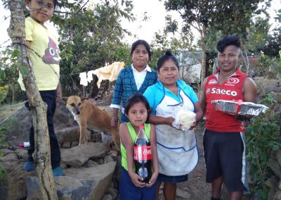 A Honduran Family receiving their Christmas dinner