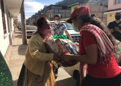 Woman receiving a Christmas basket in Xela